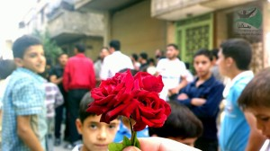 Protesters gift roses to soldiers of the Syrian army, but their gift is returned with live fire.