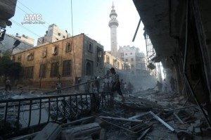 The effects of destruction left by explosive barrels on the Sha'aar district