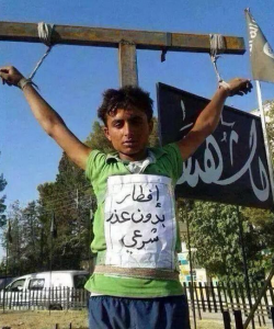A child is killed and hung by ISIS due to the fact that he broke his fast in Ramadan for no reason.
