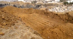 The graveyard is prepared for the burial of the victims of the al-Haarah massacre