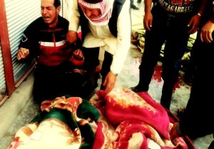 Relatives of victims of Jasim massacre today crying around the bodies