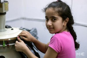 Nevene Omar (12 years) works at a Tailor shop in Turkey- image from the Middle East Eye