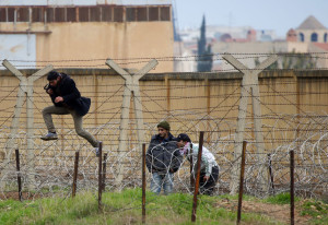 syrian refugees barbed wire