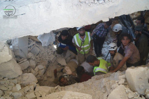 Officers of the Civil Defence searching for survivors