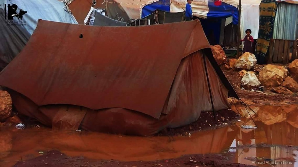 A tent in Atmah Refugee Camp, Turkey, begins sinking into the water