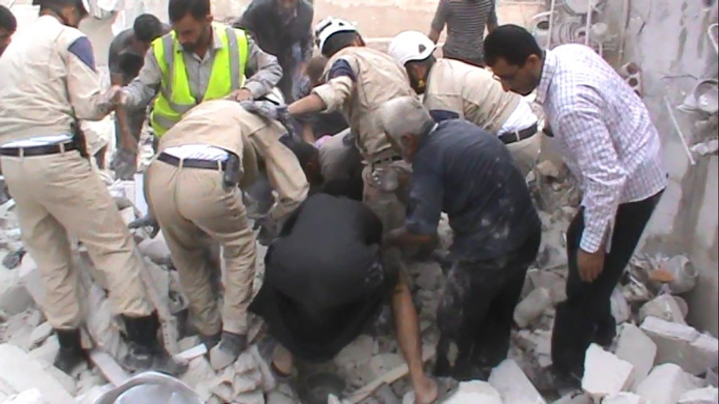 Members of the Civil Defence rescue the injured