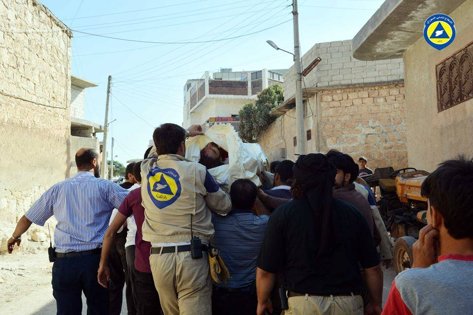 Members of the civil defence prepare their colleague Abdul Razaq Abood, who was killed in the air strikes on Sarmeen, for burial.