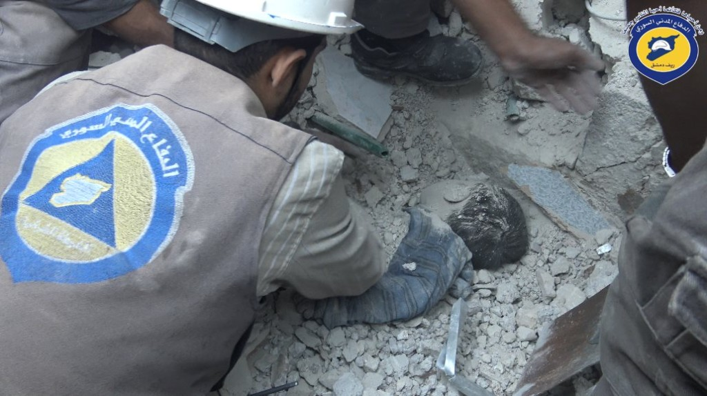 A child is removed from underneath the rubble
