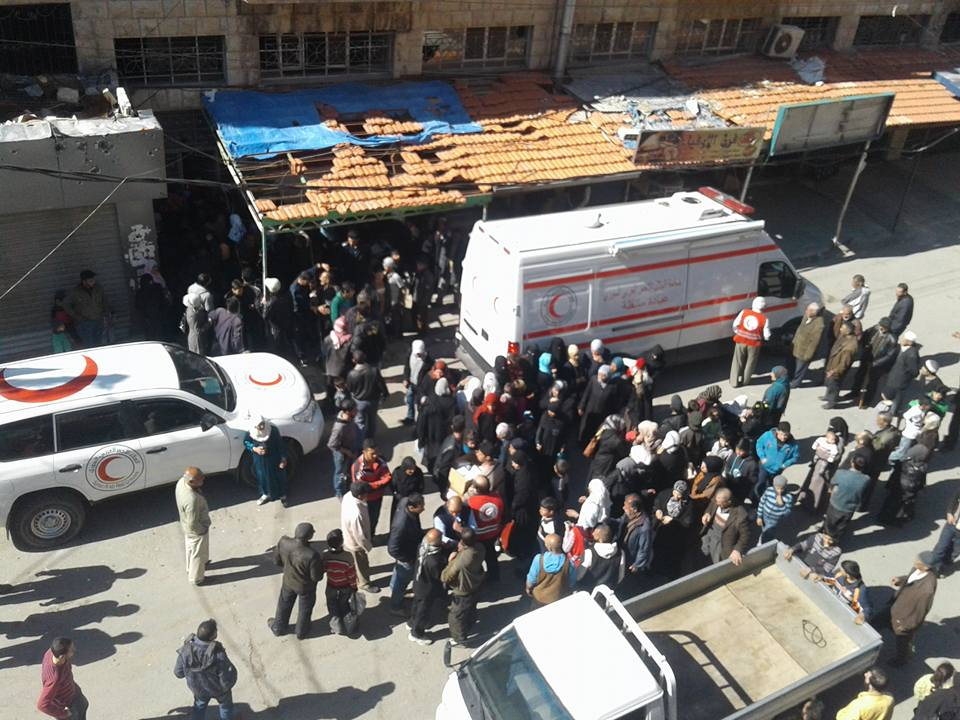 Families gather around the mobile surgery in Madaya