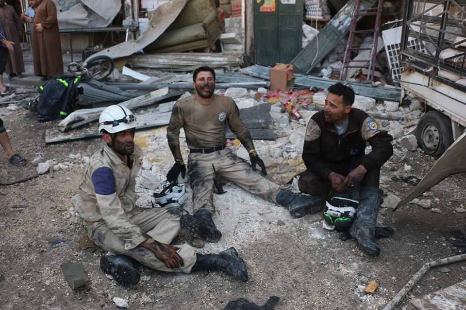 Members of the civil defence, after finishing their search for the victims and injured of the massacre in Tareeq al-Bab
