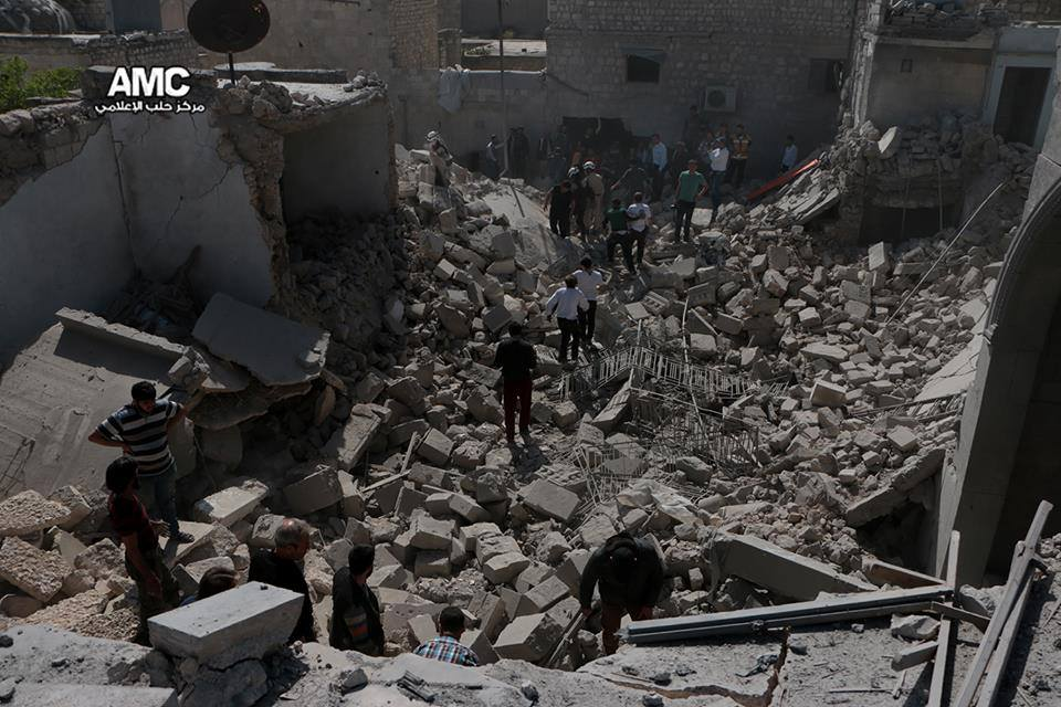 Civilians attempt to search for survivors amongst the rubble in Jub al-Qubah, following the bombing.