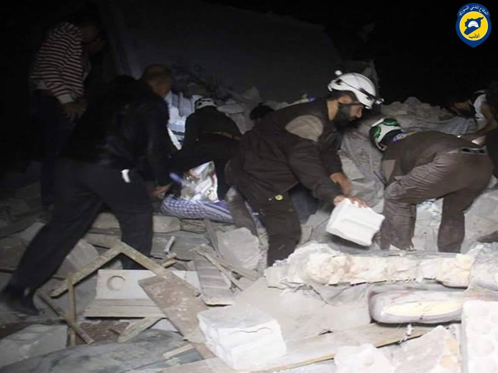 Members of the civil defence remove victims of the bombing in Bansh