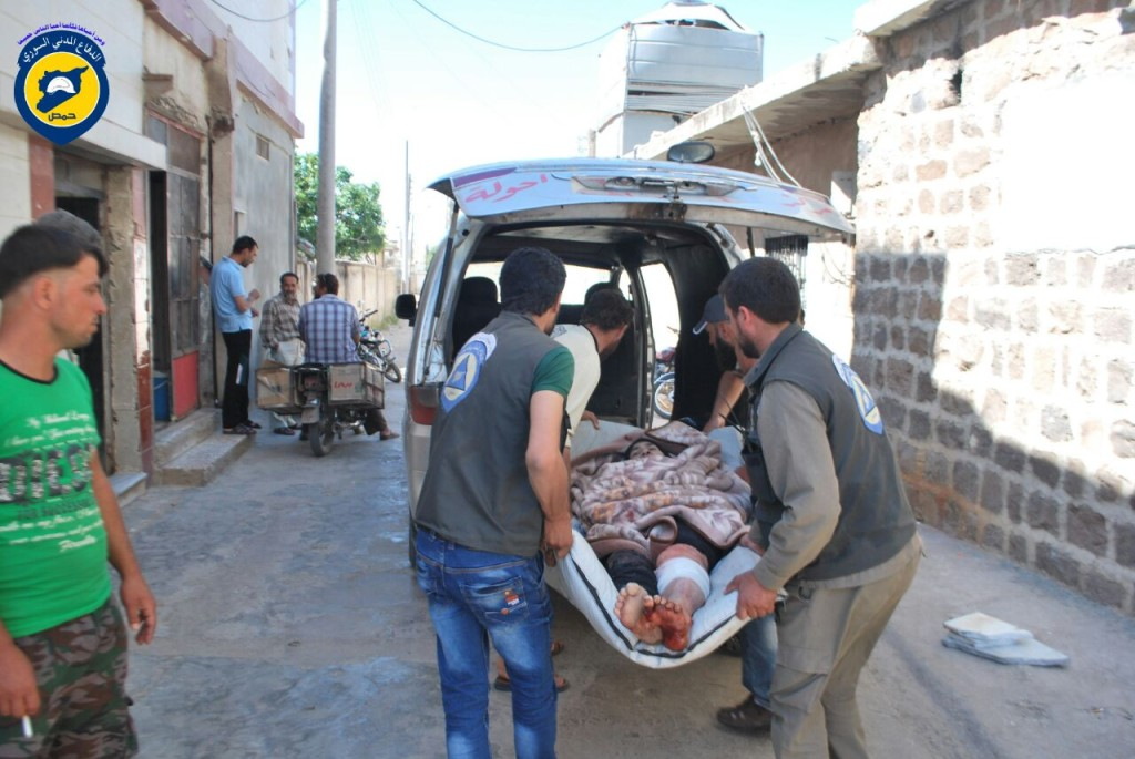 Members of the civil defence transport a man injured from the air strikes on Horbanfsa