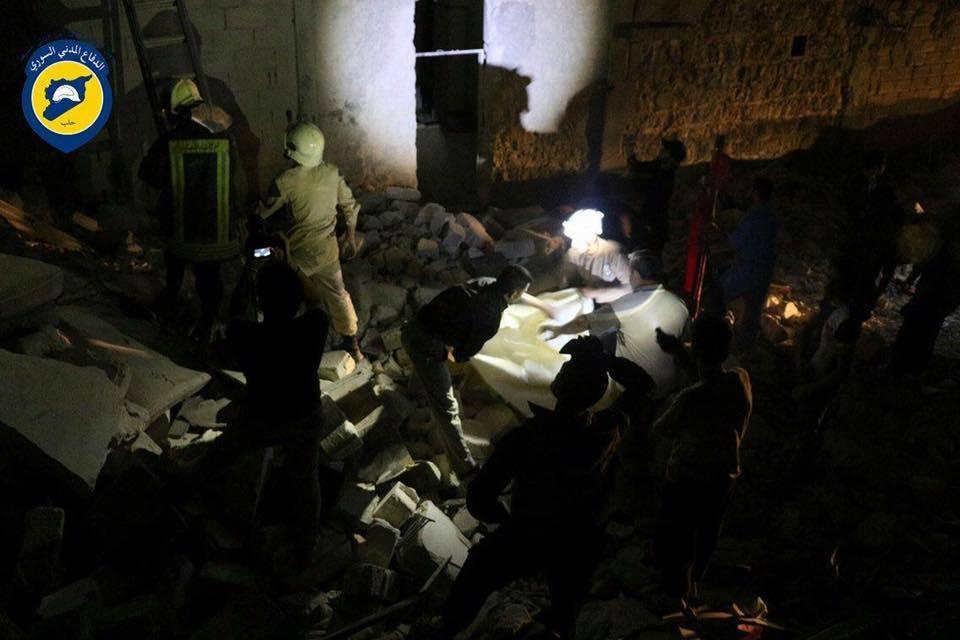 Members of the civil defence search for survivors in Al-Sukari