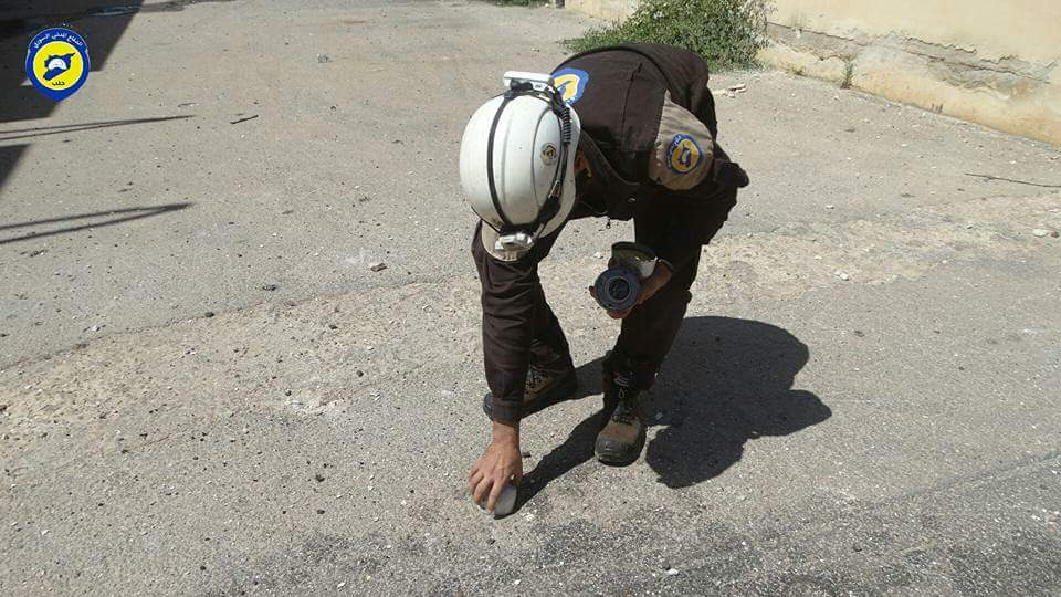 A civil defence officer clears off remnants of a bomb in Hayan