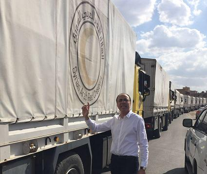 The Egyptian foreign ministy published photos of the Egyptian ambassador in Damascus, Mohammed Tharwat Saleem, posing with the convoy before it left for Douma.
