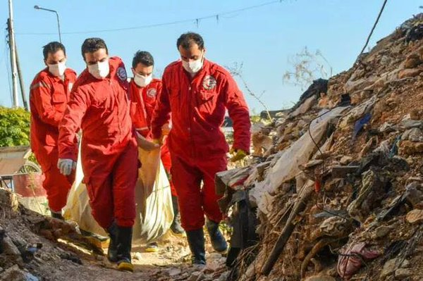 The Red Crescent gathered bodies from al-Zara and transferred them to hospitals in Homs and Hama