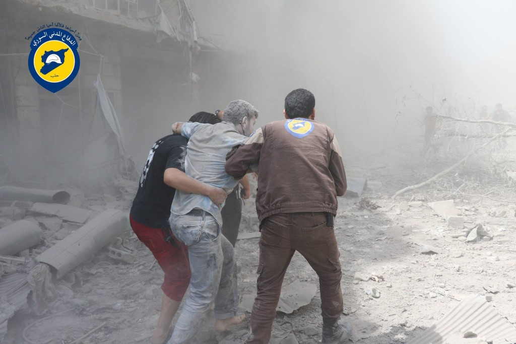 Civil Defence officers rescue survivors from underneath the rubble