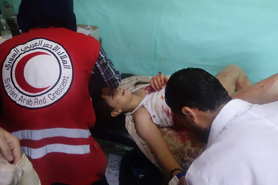 Members of the Syrian Arab Crescent transport the injured