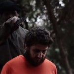 طفل داعشي يذبح قيادياً في فصيل معارض لداعش والأسد