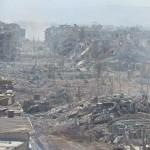قوات النظام تمارس النهب على أنقاض مخيم اليرموك